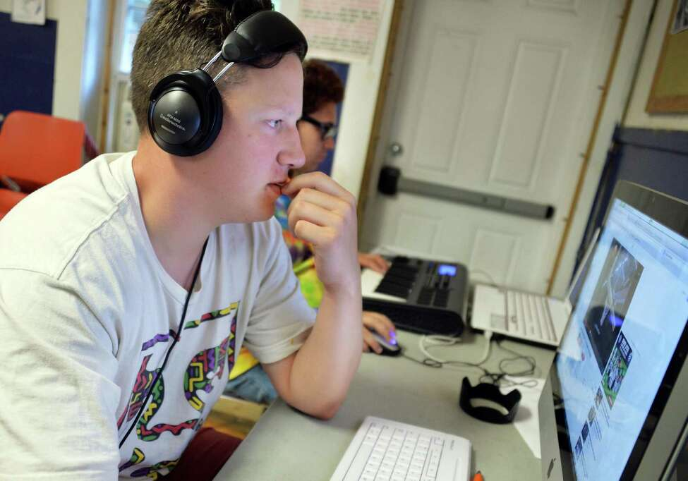 YouthFX student Freddie Boehrer, 18, of Albany works on post production of his project Thursday August 7, 2014, in Albany, NY. Film eXperience is a 6-week summer program where youth ages 14 to 18 learn about what it takes to make movies. (John Carl D'Annibale / Times Union)