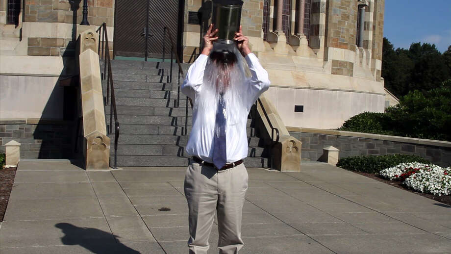 To raise awareness for ALS (amyotrophic lateral sclerosis or Lou Gehrig?s disease) and on a challenge from his son, Union College President Stephen Ainlay took the Ice Bucket Challenge on Thursday in front of Nott Memorial. Participants keep the challenge going. It can be seen on youtube.com. ( Christen Gowan / Special to the Times Union )