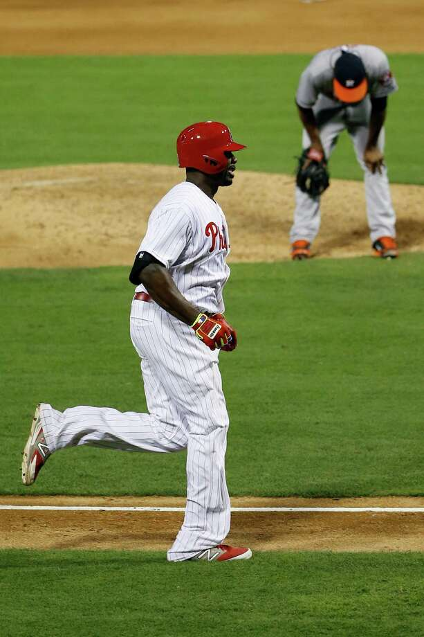 Philadelphia Phillies' Ryan Howard rounds the bases after hitting a grand slam off Houston Astros relief pitcher Tony Sipp during the eighth inning of an interleague baseball game, Thursday, Aug. 7, 2014, in Philadelphia. Philadelphia won 6-5. (AP Photo/Matt Slocum) Photo: Matt Slocum, Associated Press / AP