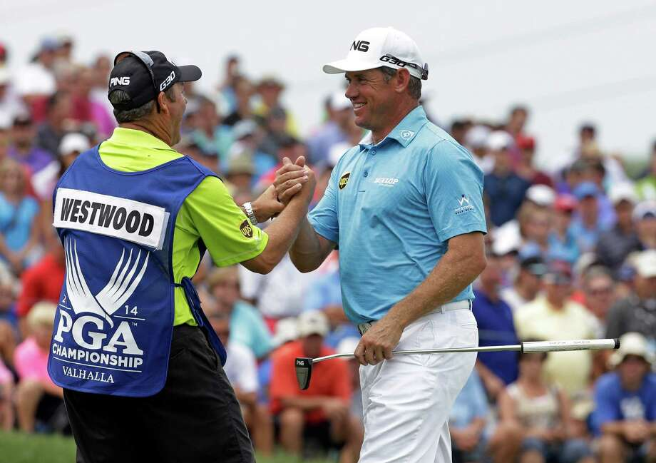 Lee Westwood, right, who has yet to win a major, is all smiles after getting off to a good start at the PGA Championship on Thursday. The Englishman fired an opening-round 65 to share a one-shot lead with two others at Valhalla Golf Club. Photo: David J. Phillip, STF / AP