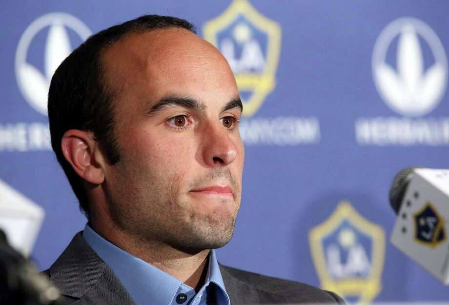Los Angeles Galaxy forward Landon Donovan, widely considered as America's best ever footballer, announces will retire at the end of the MLS season, at a news conference at StubHub Center in Carson, Calif., Thursday, Aug. 7, 2014. The 32-year-old is the top goal scorer in MLS history and a five-time league champion.  (AP Photo/Nick Ut) Photo: Nick Ut, STF / AP