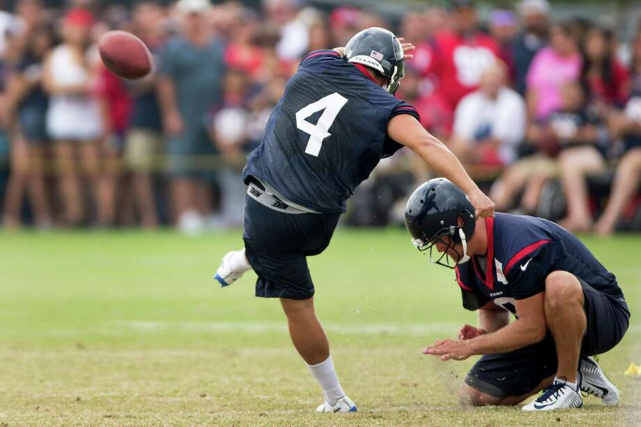 Randy Bullock, left, works on his field-goal form out of the hold of Shane Lechler as the Texans prepare for a couple rule changes in the first two exhibitions. Photo: Brett Coomer, Staff / © 2014 Houston Chronicle