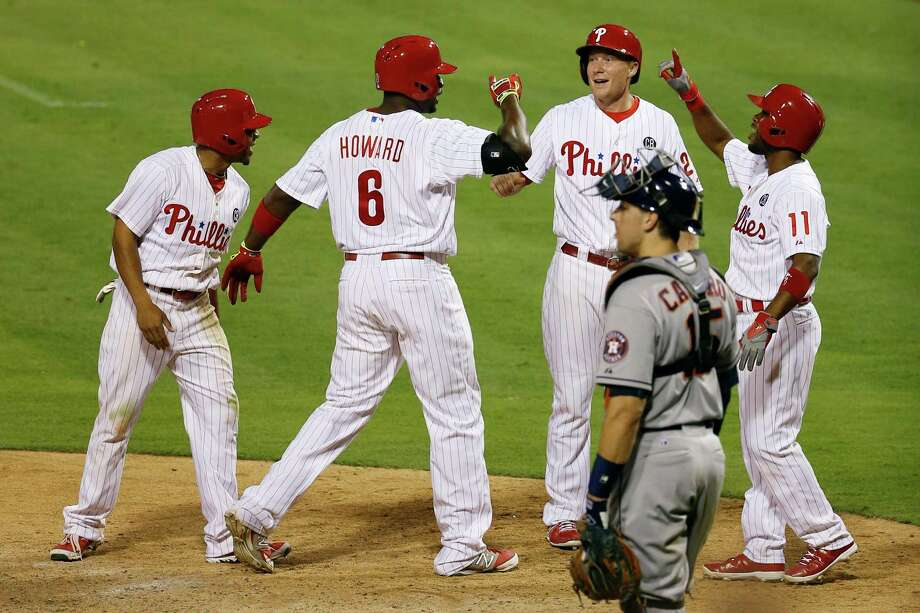 Ryan Howard (6) gets the star treatment from teammates after slugging an eighth-inning grand slam that propelled the Phillies past the Astros. Photo: Matt Slocum, STF / AP