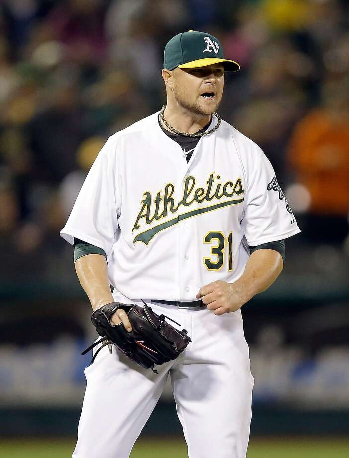Jon Lester reacts to escaping a bases-full jam in the sixth. Photo: Ezra Shaw, Getty Images