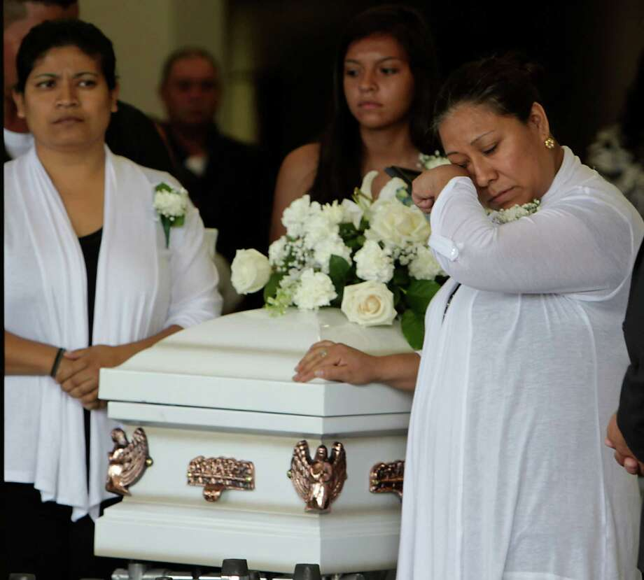 The funeral for Valentin Guzman, his wife, Elvira Guzman-Santoyo, and three of their children. The family was driving to Oklahoma on June 29, 2014, when they were struck by a truck traveling the wrong direction on the north Sam Houston Parkway. Photo: James Nielsen, Houston Chronicle / © 2014  Houston Chronicle