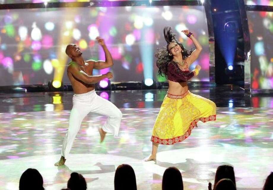 "SO YOU THINK YOU CAN DANCE: Top 10 contestant Bridget Whitman (R) and all-star Brandon Bryant (L) perform a Bollywood Disco routine to ""Dil Bole Hadippa"" choreographed by Nakul Dev Mahajan on SO YOU THINK YOU CAN DANCE airing Wednesday, August 6 (8:00-10:00 PM ET/PT) on FOX. ©2014 FOX Broadcasting Co. Cr: Adam Rose / 1"