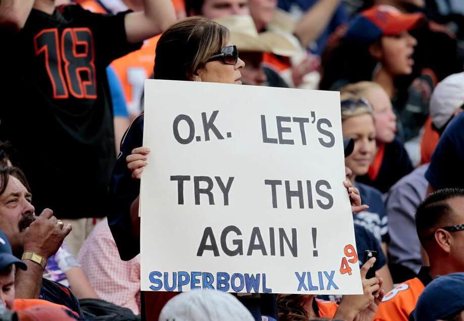 A Denver Broncos fan holds a sign during the first half of an NFL preseason football game against the Seattle Seahawks, Thursday, Aug. 7, 2014, in Denver. (AP Photo/Joe Mahoney) Photo: Joe Mahoney, AP