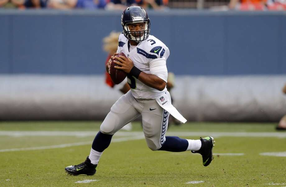 Seattle Seahawks quarterback Russell Wilson (3) looks to throw against the Denver Broncos during the first half of an NFL preseason football game, Thursday, Aug. 7, 2014, in Denver. (AP Photo/Jack Dempsey) Photo: Jack Dempsey, AP