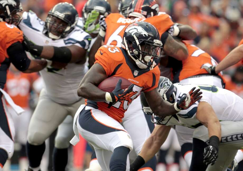 Denver Broncos running back Ronnie Hillman (23) runs against the Seattle Seahawks during the first half of an NFL preseason football game, Thursday, Aug. 7, 2014, in Denver. (AP Photo/Joe Mahoney) Photo: Joe Mahoney, AP