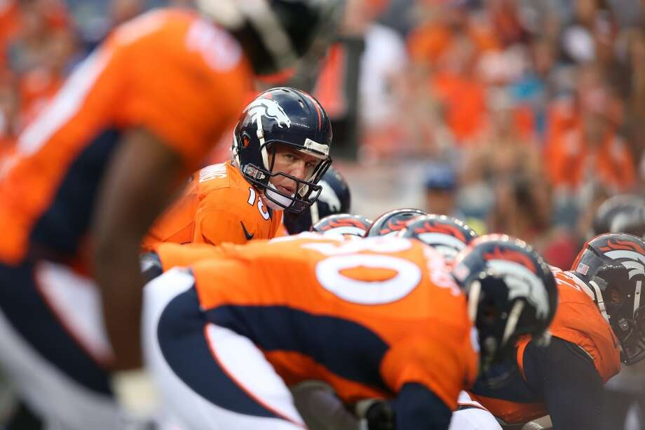 Quarterback Peyton Manning #18 of the Denver Broncos waits for the snap against the Seattle Seahawks during preseason action at Sports Authority Field at Mile High on August 7, 2014 in Denver, Colorado.  (Photo by Doug Pensinger/Getty Images) Photo: Doug Pensinger, Getty Images
