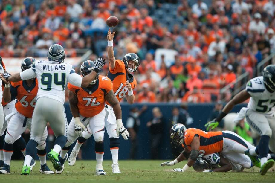 Quarterback Peyton Manning #18 of the Denver Broncos passes the ball against the Seattle Seahawks during preseason action at Sports Authority Field at Mile High on August 7, 2014 in Denver, Colorado.  (Photo by Dustin Bradford/Getty Images) Photo: Dustin Bradford, Getty Images
