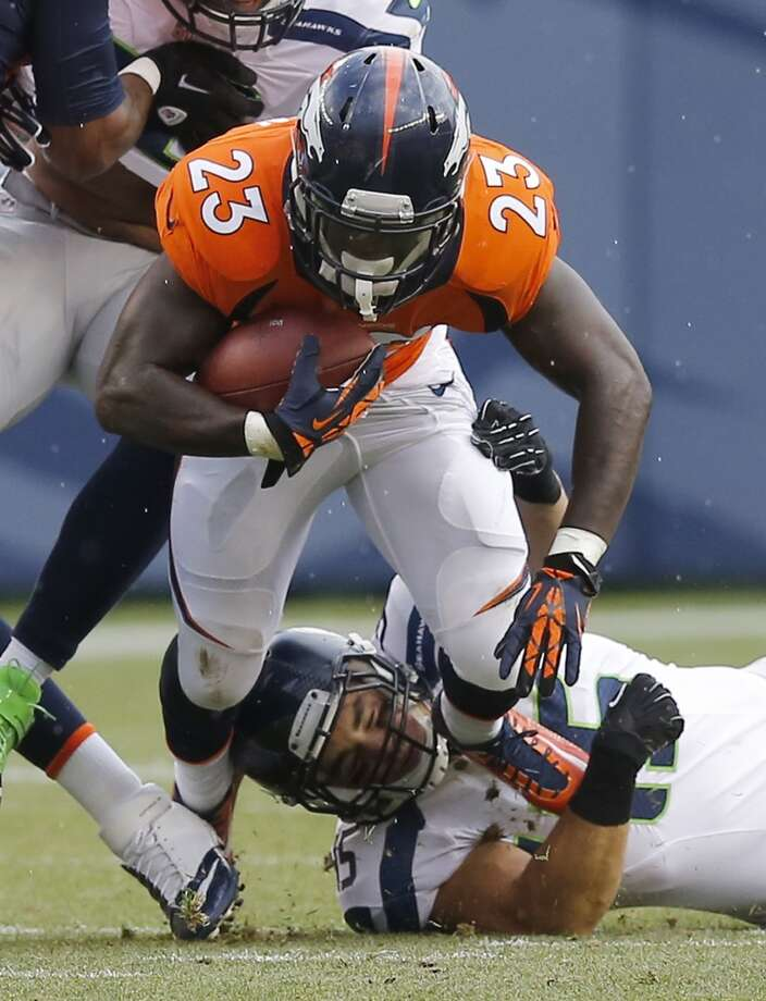 Denver Broncos running back Ronnie Hillman is tackled by Seattle Seahawks linebacker Brock Coyle  during the first half of an NFL preseason football game, Thursday, Aug. 7, 2014, in Denver. (AP Photo/Jack Dempsey) Photo: Jack Dempsey, AP