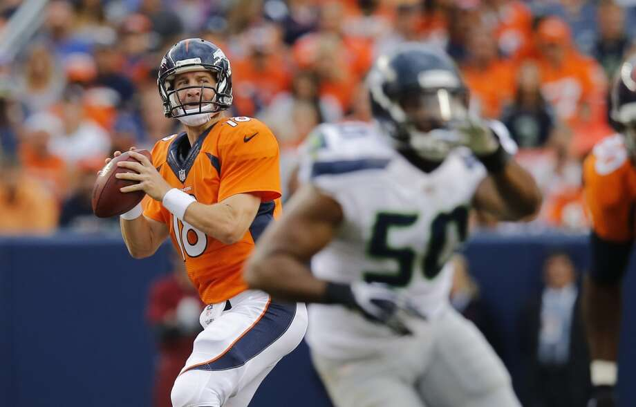 Denver Broncos quarterback Peyton Manning (18) throws against the Seattle Seahawks during the first half of an NFL preseason football game, Thursday, Aug. 7, 2014, in Denver. (AP Photo/Jack Dempsey) Photo: AP