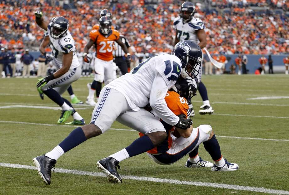 Denver Broncos wide receiver Wes Welker, right, is stopped short of the goal line by Seattle Seahawks cornerback Byron Maxwell during the first half of an NFL preseason football game, Thursday, Aug. 7, 2014, in Denver. (AP Photo/Jack Dempsey) Photo: Jack Dempsey, AP