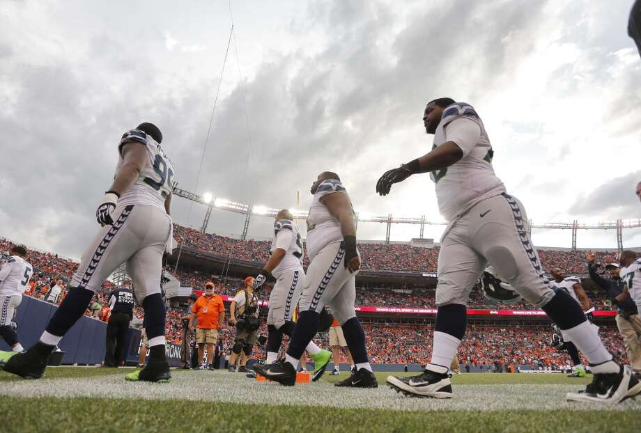 Seattle Seahawks players leave the field after play was suspended due to lighting during the first half of an NFL preseason football game against the Denver Broncos, Thursday, Aug. 7, 2014, in Denver. (AP Photo/Joe Mahoney) Photo: Joe Mahoney, AP