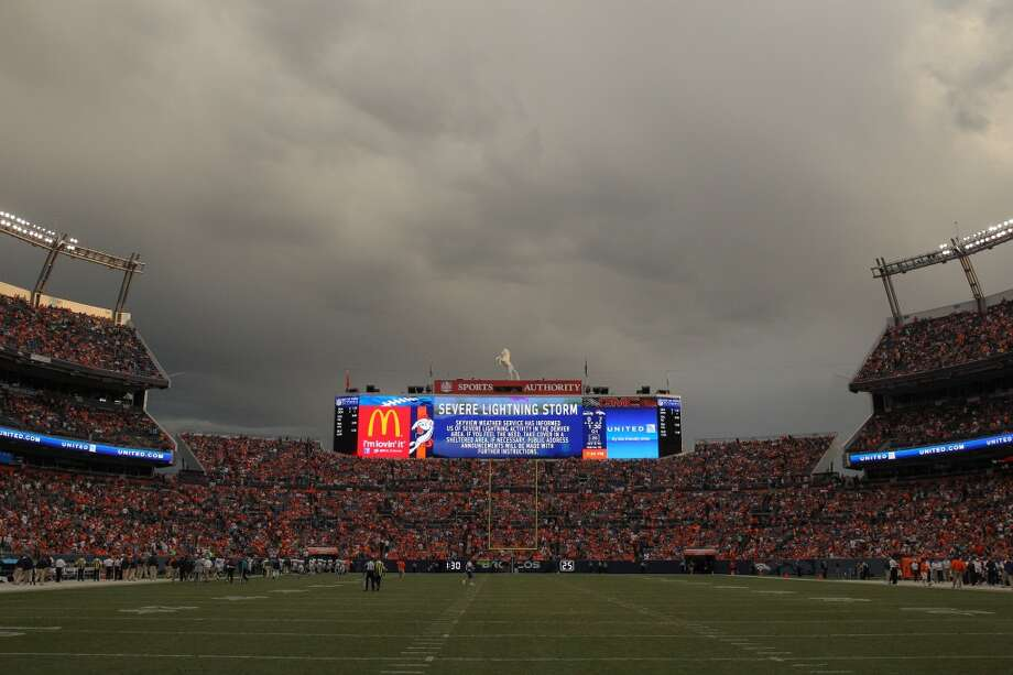 Players are called off the field during a lightning delay during preseason action between the Denver Broncos and the Seattle Seahawks at Sports Authority Field at Mile High on August 7, 2014 in Denver, Colorado.  (Photo by Doug Pensinger/Getty Images) Photo: Doug Pensinger, Getty Images