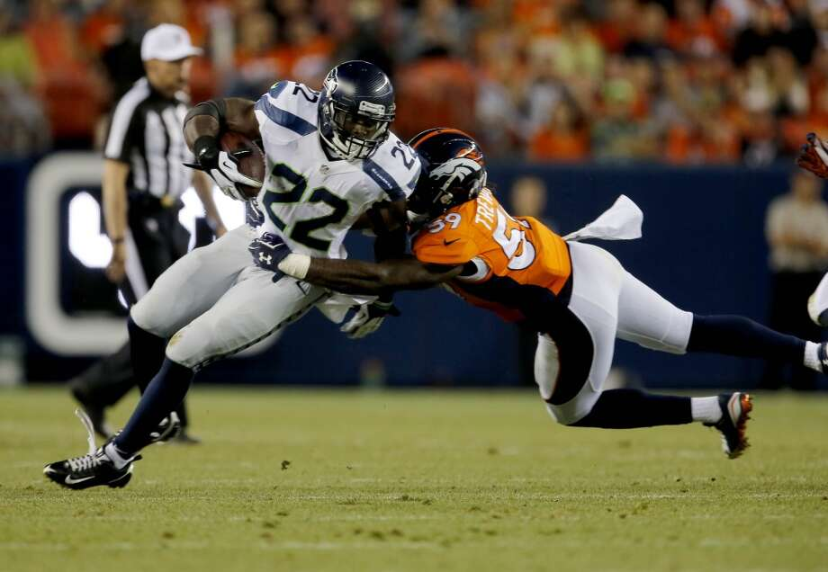 Seattle Seahawks running back Robert Turbin (22) is tackled by Denver Broncos outside linebacker Danny Trevathan (59) during the first half of an NFL preseason football game, Thursday, Aug. 7, 2014, in Denver. (AP Photo/Joe Mahoney) Photo: Joe Mahoney, AP
