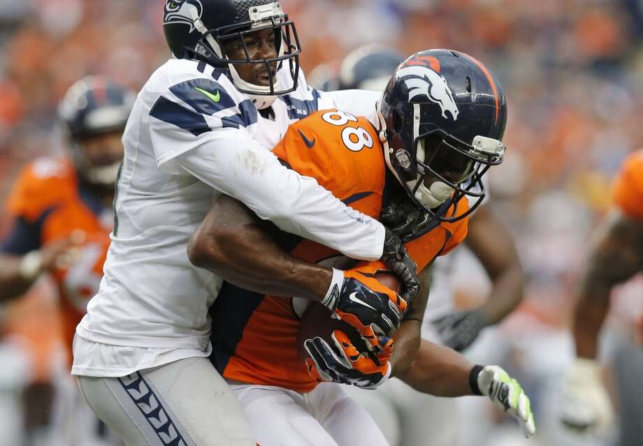 Denver Broncos wide receiver Demaryius Thomas (88) is tackled by Seattle Seahawks cornerback Byron Maxwell during the first half of an NFL preseason football game, Thursday, Aug. 7, 2014, in Denver. (AP Photo/Jack Dempsey) Photo: AP