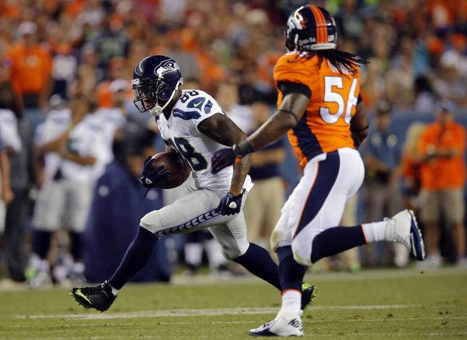 Seattle Seahawks wide receiver Phil Bates (88) runs after the catch as Denver Broncos outside linebacker Nate Irving (56) pursues during the first half of an NFL preseason football game, Thursday, Aug. 7, 2014, in Denver. (AP Photo/Jack Dempsey) Photo: AP