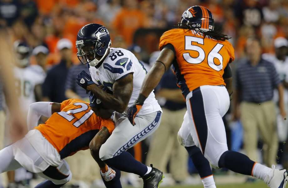 Seattle Seahawks wide receiver Phil Bates (88) runs after the catch as Denver Broncos outside linebacker Nate Irving (56) and Aqib Talib pursue during the first half of an NFL preseason football game, Thursday, Aug. 7, 2014, in Denver. (AP Photo/Jack Dempsey) Photo: AP