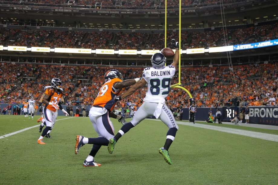 Wide receiver Doug Baldwin #89 of the Seattle Seahawks goes up for a catch in the end zone as outside linebacker Danny Trevathan #59 of the Denver Broncos covers him and is called for pass interference during preseason action at Sports Authority Field at Mile High on August 7, 2014 in Denver, Colorado.  (Photo by Doug Pensinger/Getty Images) Photo: Doug Pensinger, Getty Images