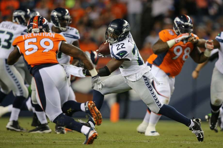 Running back Robert Turbin #22 of the Seattle Seahawks rushes against the Denver Broncos during preseason action at Sports Authority Field at Mile High on August 7, 2014 in Denver, Colorado.  (Photo by Doug Pensinger/Getty Images) Photo: Doug Pensinger, Getty Images