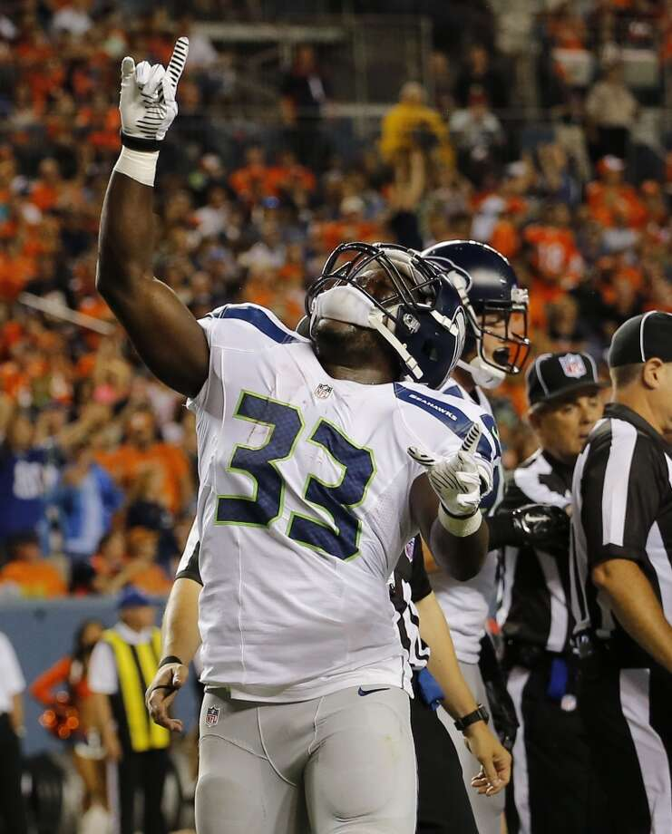 Seattle Seahawks running back Christine Michael (33) points upward after scoring a touchdown against the Denver Broncos during the first half of an NFL preseason football game, Thursday, Aug. 7, 2014, in Denver. (AP Photo/Jack Dempsey) Photo: Jack Dempsey, AP