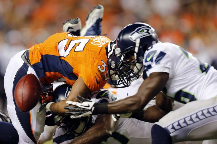 Denver Broncos running back Kapri Bibbs (35) fumbles as Seattle Seahawks' Michael Robinson chases down the football during the second half of an NFL preseason football game, Thursday, Aug. 7, 2014, in Denver. Denver recovered the fumble. (AP Photo/Joe Mahoney) Photo: Joe Mahoney, AP