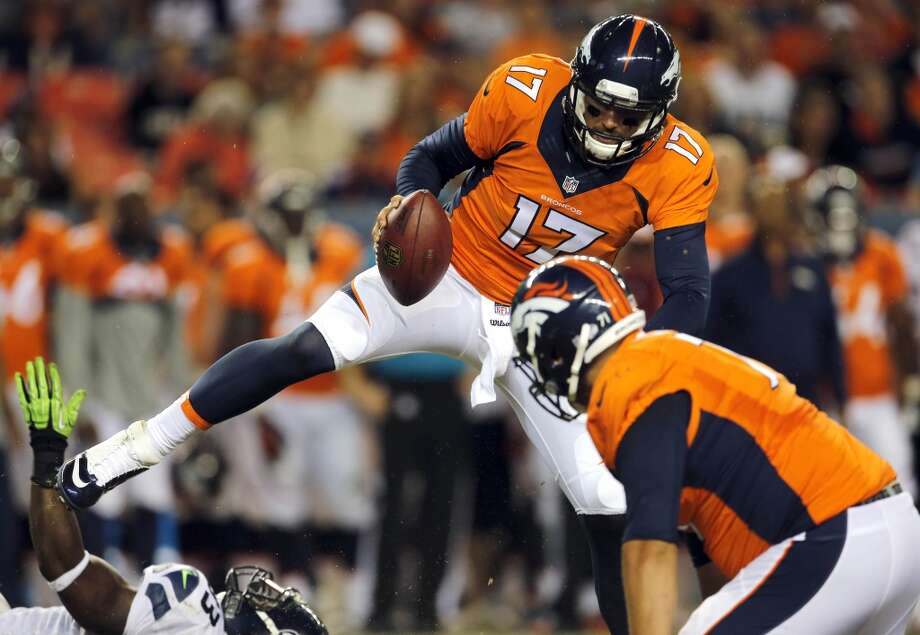 Denver Broncos quarterback Brock Osweiler (17) avoids a hit during the second half of an NFL preseason football game against the Seattle Seahawks, Thursday, Aug. 7, 2014, in Denver. (AP Photo/Joe Mahoney) Photo: AP