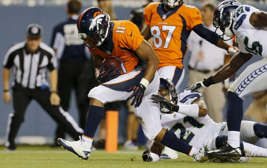 Denver Broncos wide receiver Jordan Norwood (11) scores a touchdown as Seattle Seahawks' Terrell Thomas (21) defends during the second half of an NFL preseason football game, Thursday, Aug. 7, 2014, in Denver. (AP Photo/Joe Mahoney) Photo: AP