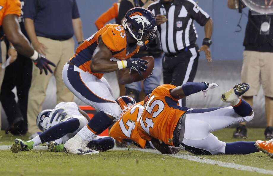 Denver Broncos linebacker Steven Johnson intercepts a pass intended for Seattle Seahawks wide receiver Ricardo Lockette, left, during the second half of an NFL preseason football game, Thursday, Aug. 7, 2014, in Denver. The Broncos won 21-16. (AP Photo/Jack Dempsey) Photo: AP