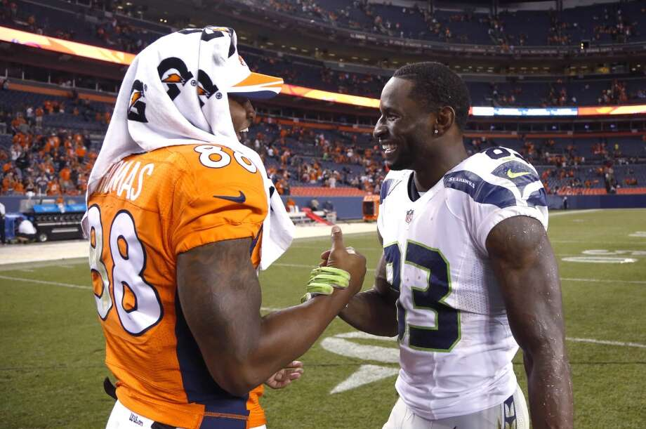 Seattle Seahawks wide receiver Ricardo Lockette (83) greets Denver Broncos wide receiver Demaryius Thomas (88) after an NFL preseason football game, Thursday, Aug. 7, 2014, in Denver. The Broncos won 21-16. (AP Photo/Jack Dempsey) Photo: AP