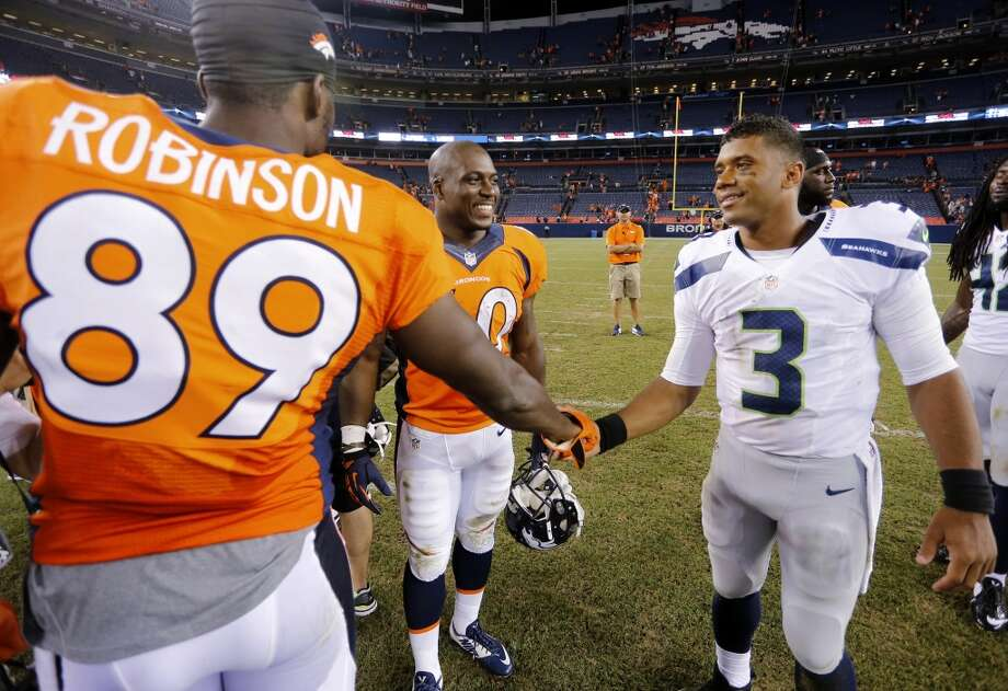 Seattle Seahawks quarterback Russell Wilson (3) greets Denver Broncos tight end Gerell Robinson (89) after an NFL preseason football game, Thursday, Aug. 7, 2014, in Denver. The Broncos won 21-16. (AP Photo/Joe Mahoney) Photo: AP