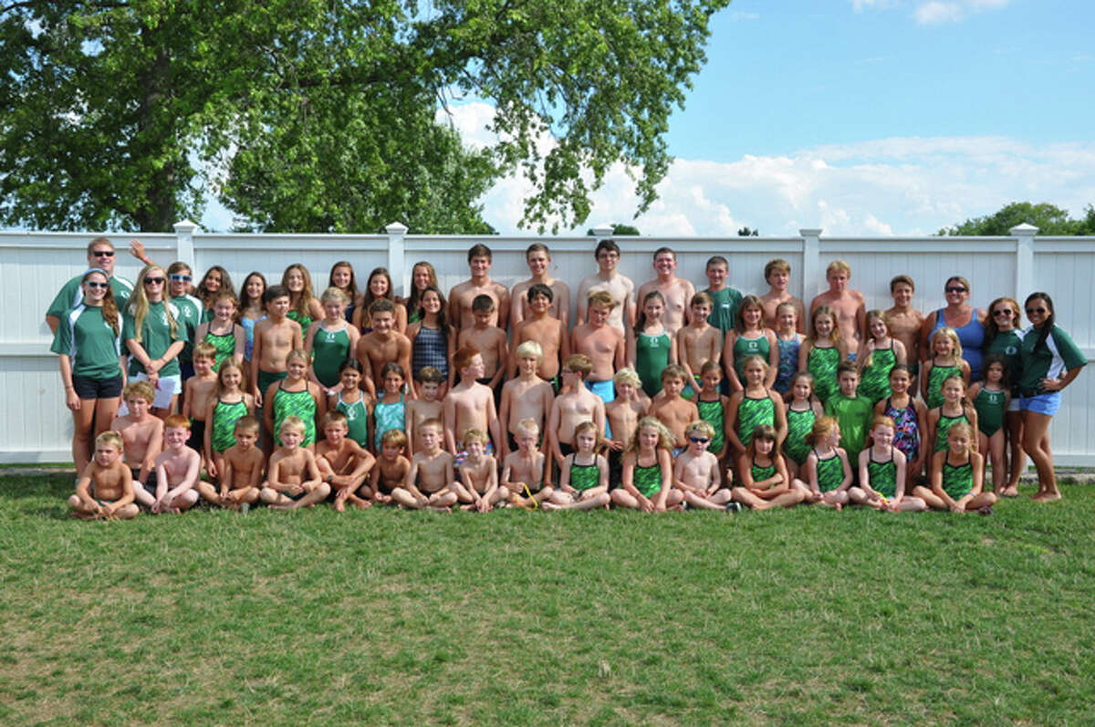 The Country Club of Darien swimming and diving team poses after finishing its season 6-0 and winning its division this 2014 summer.