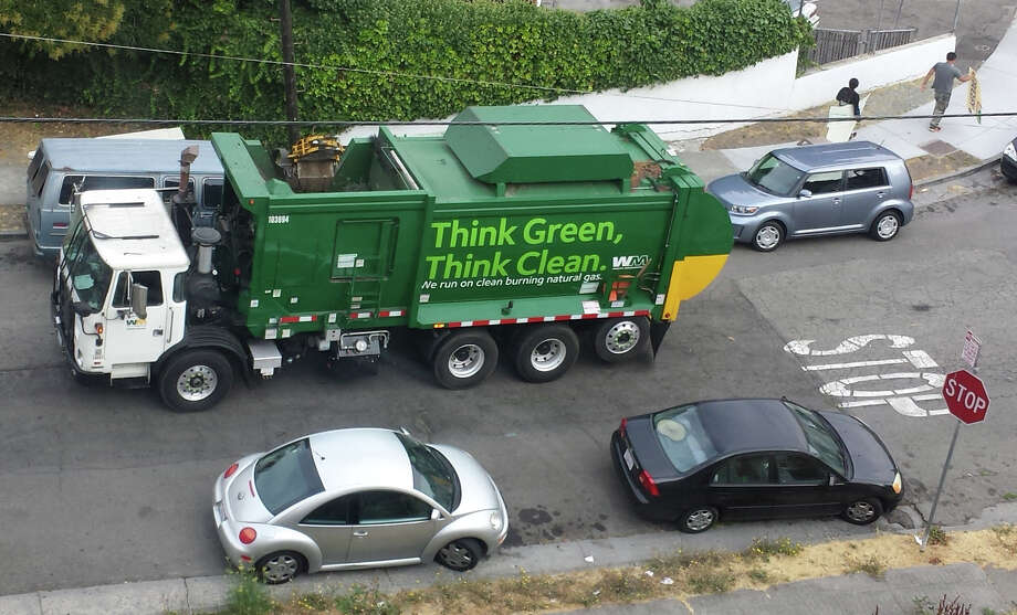 A Waste Management truck works a route in Oakland on Aug. 8, 2014. Photo: SF Gate / Douglas Zimmerman