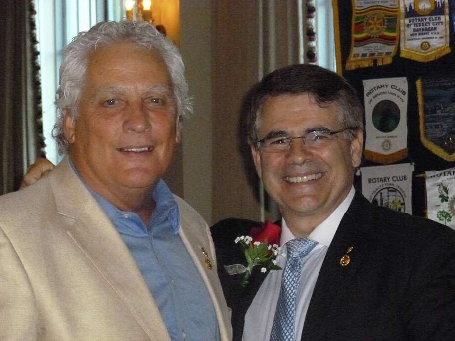 Robert Walters, left, was named Sugar Land Rotarian of the Year and  is pictured with outgoing president Ward Pendleton. Photo: Sugar Land Rotary
