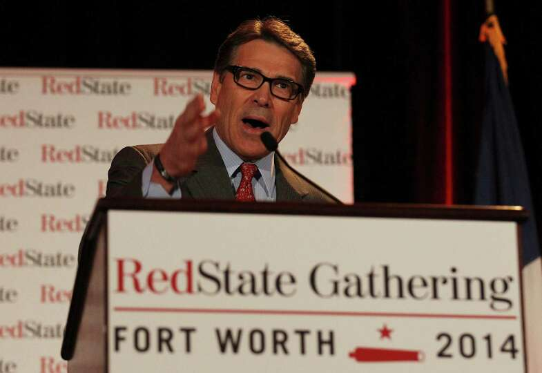 Governor Rick Perry addresses an audience at the RedState Gathering in Fort Worth on Friday, August