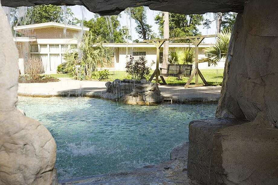 2190 Thomas Rd, Beaumont: $1,250,000The pool has rock waterfalls and a large hot tub. The 2,000 square-foot pool house has two bathrooms. Photo: Zillow