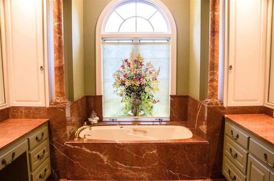 1770 Thomas Rd, Beaumont: $930,000The master bath features Italian marble, a jetted tub and separate steam shower. Photo: Zillow