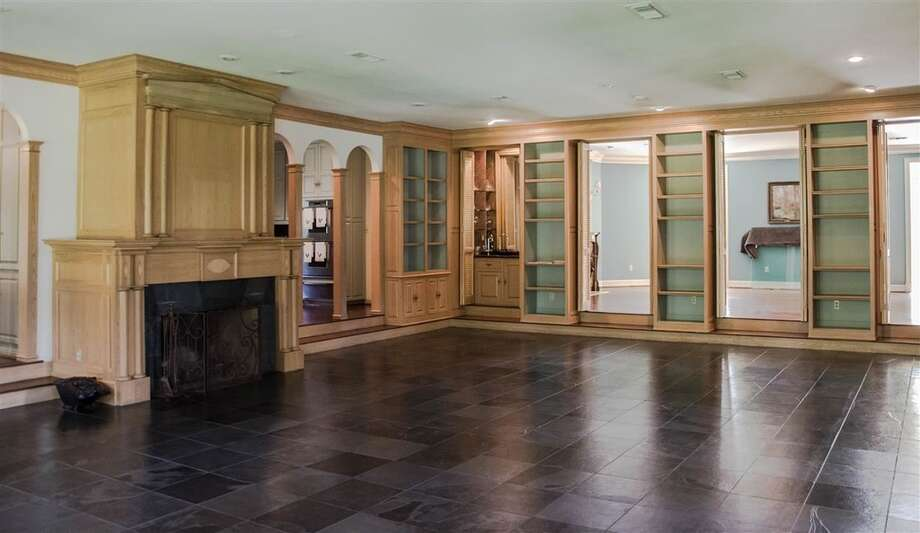 1770 Thomas Rd, Beaumont: $930,000The family room features slate flooring, a wet-bar and french doors that open to a large backyard. Photo: Zillow
