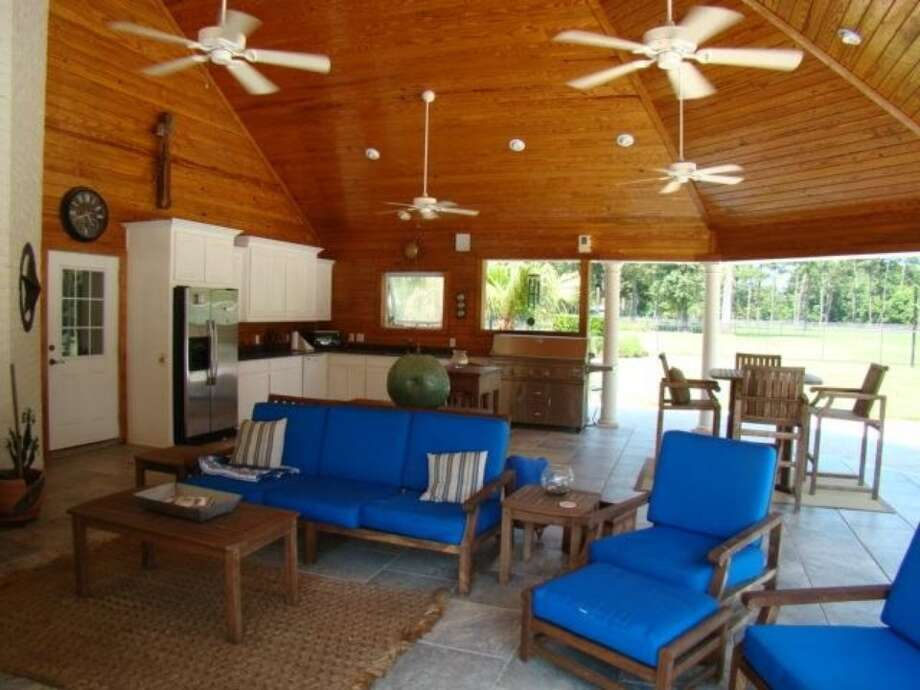 1193 Moore Rd, Beaumont: $949,000The home has a large outdoor kitchen and living space. Photo: Zillow