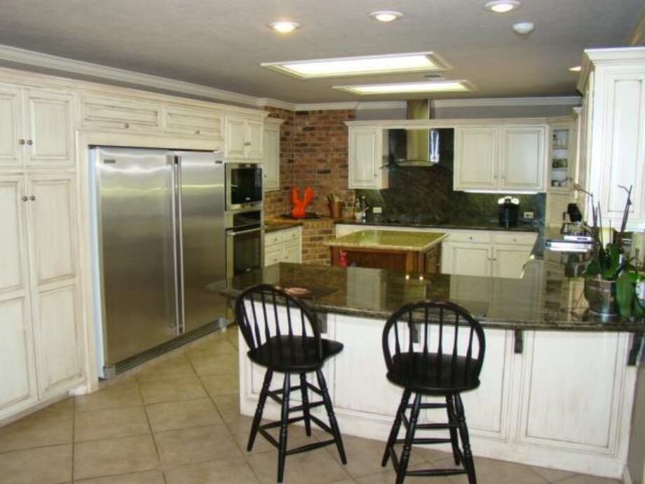 1193 Moore Rd, Beaumont: $949,000The kitchen offers stainless steel appliances and custom cabinetry. Photo: Zillow