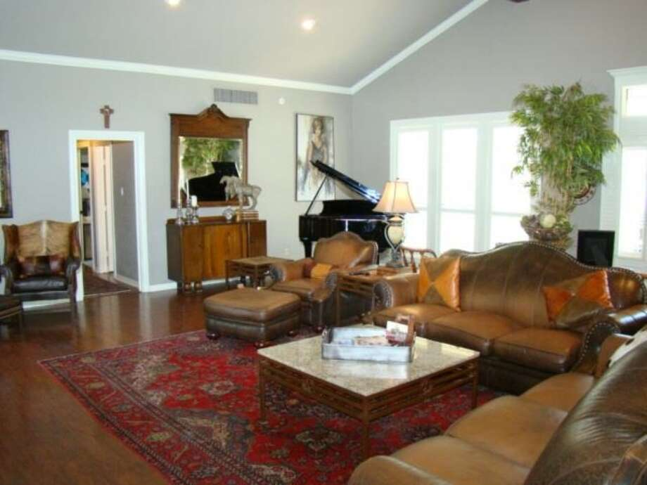 1193 Moore Rd, Beaumont: $949,000The large living area features wood flooring and high ceilings. Photo: Zillow