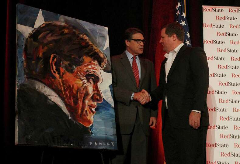 Governor Rick Perry (left) shakes hands with RedState.com's Erik Erikson after being presented with