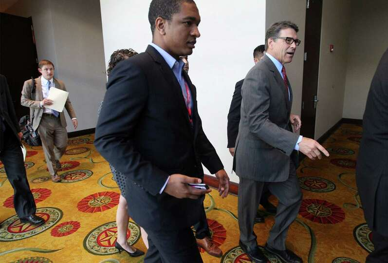 Governor Rick Perry leaves the conference hall after addressing an audience at the RedState Gatherin