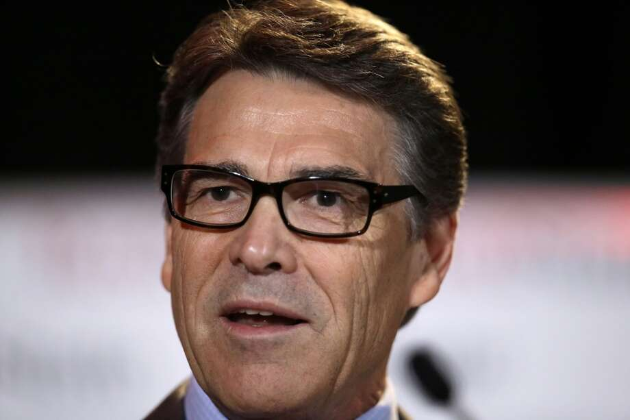 Governor Rick Perry delivers a speech to nearly 300 in attendance at the 2014 Red State Gathering, Friday, Aug. 8, 2014, in Fort Worth, Texas. Two Texans eyeing possible 2016 presidential runs, Perry and U.S. Sen. Ted Cruz, are addressing the kind of top-tier conservative event necessary to build national support, the RedState Gathering. (AP Photo/Tony Gutierrez) Photo: Associated Press