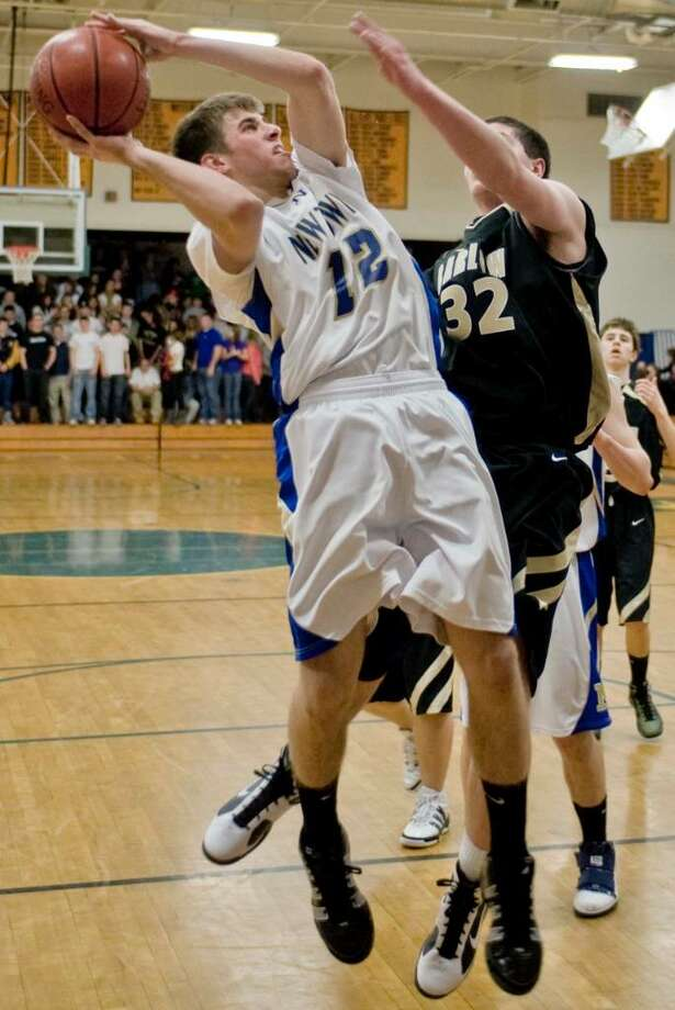 Newtown's Casey Tenney tries to make a shot during a boys basketball game against Barlow at Newtown. Friday, Jan. 8, 2010 Photo: Scott Mullin / The News-Times