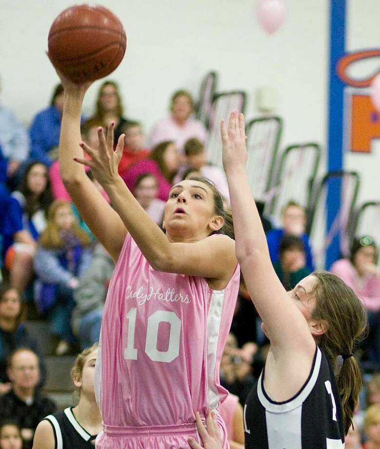 Danbury's Casey Smith (10) puts up a shot over Trumbull's Erin Moore during their FCIAC game Friday night at Danbury High.February 2010 file photo Photo: Barry Horn / The News-Times Freelance
