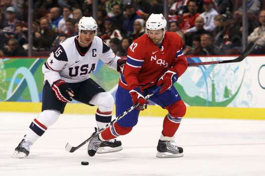 VANCOUVER, BC - FEBRUARY 18:  Jonas Andersen of Norway is pursued by Jamie Langenbrunner of The United States during the ice hockey men's preliminary game between USA and Norway on day 7 of the 2010 Winter Olympics at Canada Hockey Place on February 18, 2010 in Vancouver, Canada.  (Photo by Bruce Bennett/Getty Images) *** Local Caption *** Jonas Andersen;Jamie Langenbrunner Photo: Bruce Bennett, Getty Images / 2010 Getty Images