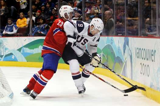 VANCOUVER, BC - FEBRUARY 18: Zach Parise of the United States battles Mats Trygg of Norway during the ice hockey men's preliminary game between USA and Norway on day 7 of the 2010 Winter Olympics at Canada Hockey Place on February 18, 2010 in Vancouver, Canada.  (Photo by Bruce Bennett/Getty Images) *** Local Caption *** Zach Parise;Mats Trygg Photo: Bruce Bennett, Getty Images / 2010 Getty Images